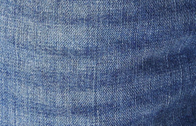Zoom matiere jean denim lavé